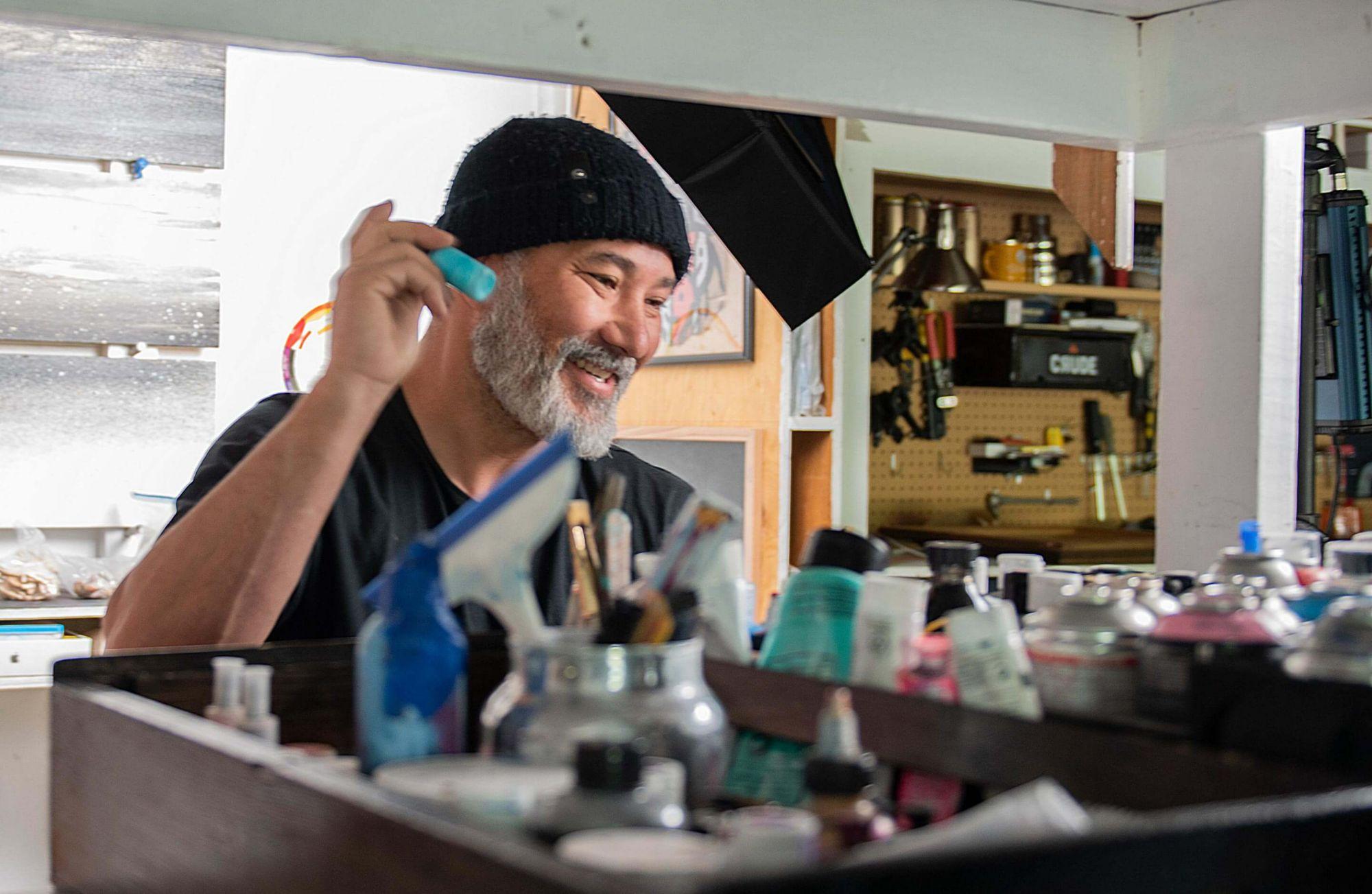 Bryan Iguchi checking his paint