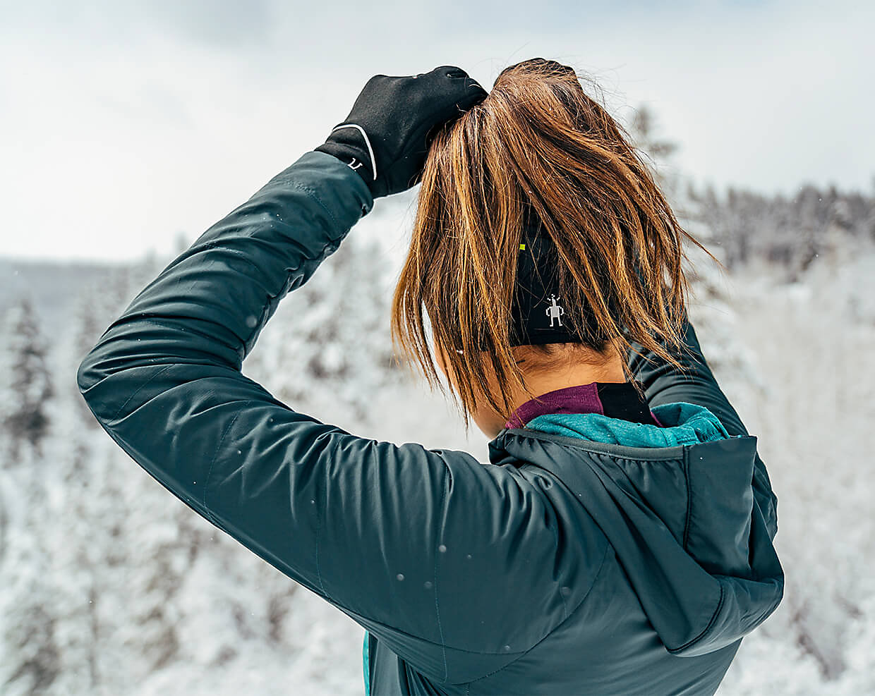 Shot from behind of woman fixing her hair